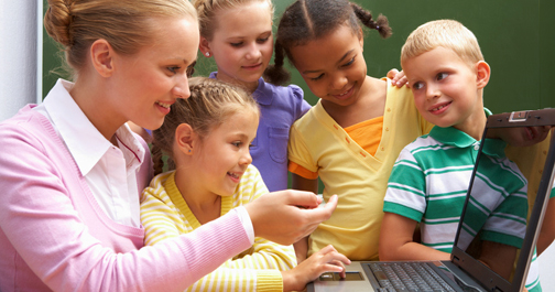 Teacher showing students inetetacher website